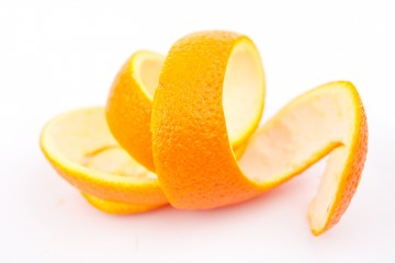 Orange peel against white background