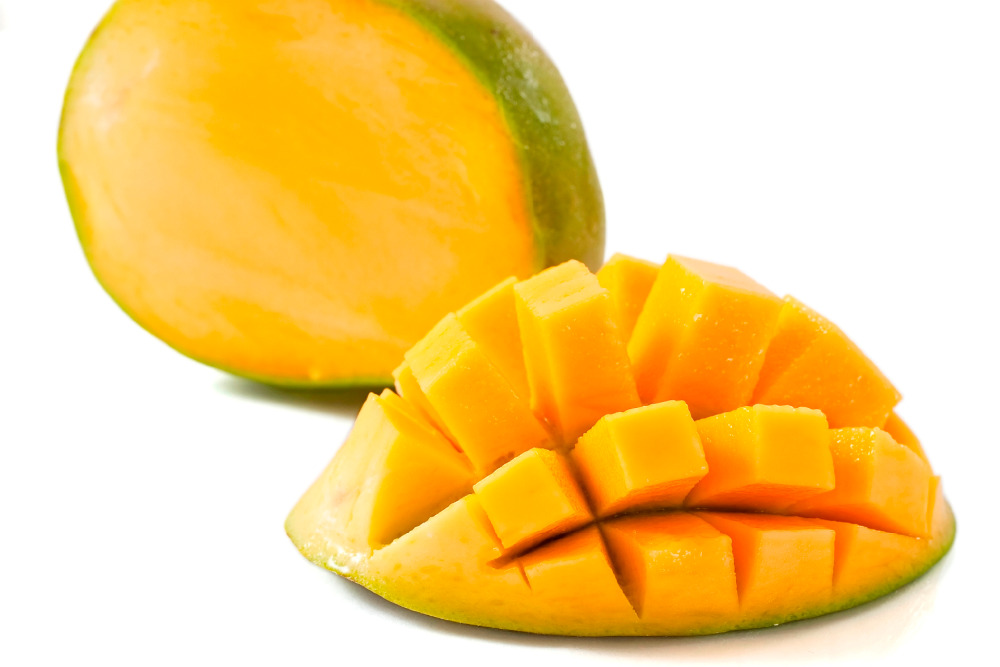 cubed mango isolated on white background with clipping path